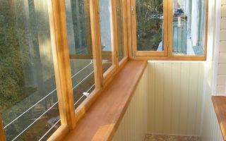 Достоинства и недостатки остекления балконов и лоджий деревянными рамами